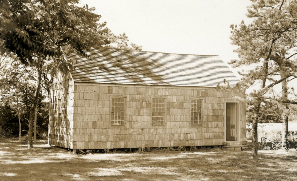 Quogue's 1822 schoolhouse behind the Library, in 1949. It was moved from the Post' property in 1948.